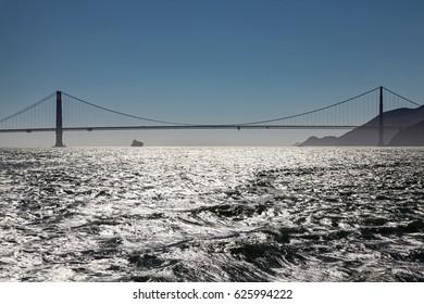 A silhouette of the Golden Gate Bridge