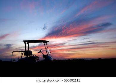 silhouette golf cart in golf course with colorful twilight sky soft cloud for background backdrop use