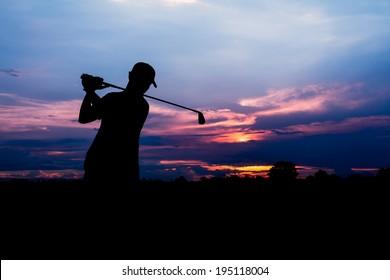 silhouette golfer at beautiful sunset
