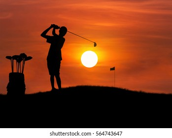 silhouette golfer hitting golf shot on sunset with leather baggage metal golf clubs