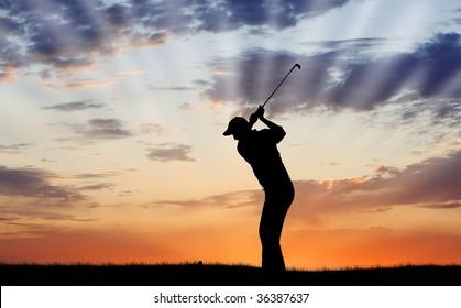 Silhouette of golfer mid-swing