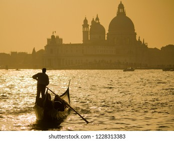 Silhouette of a gondolier during sunset overlooking the San Giorgio Maggiore in Venice, Italy