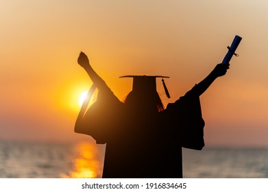 Silhouette Graduates wear a black hat to stand for congratulations on graduation,with high contrast and artificial noise in silhouette mode