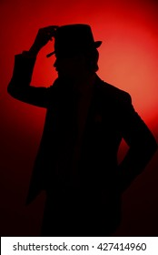 The silhouette of the  groom on a red background