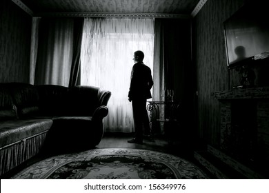 silhouette of the groom in the room. black and white