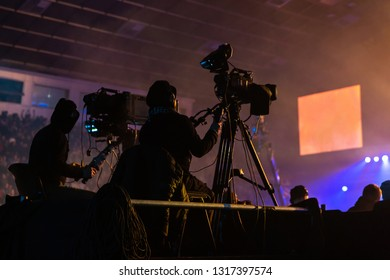 Silhouette of a group of cameramen broadcasting an event.