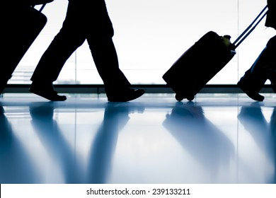 Silhouette group of passenger walking with luggage at airport