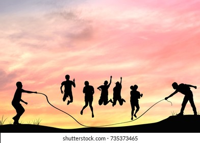 Silhouette of group people rope jumping with in twilight, teamwork and team concept