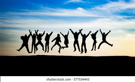 silhouette group of young people is jumping on top of the mountain
