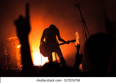 Silhouette of guitarist musician on stage at a concert