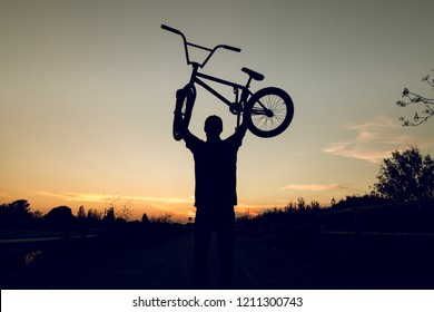 Silhouette of a guy with a bmx bicycle. BMX rider
