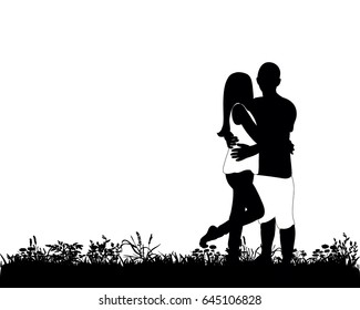 Silhouette of a guy and a girl are standing on grass