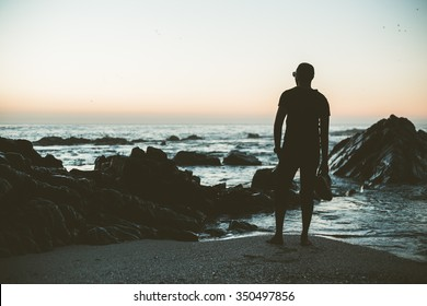 Silhouette guy staring at the beach horizon