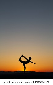 silhouette of gymnast on beach in after sunset