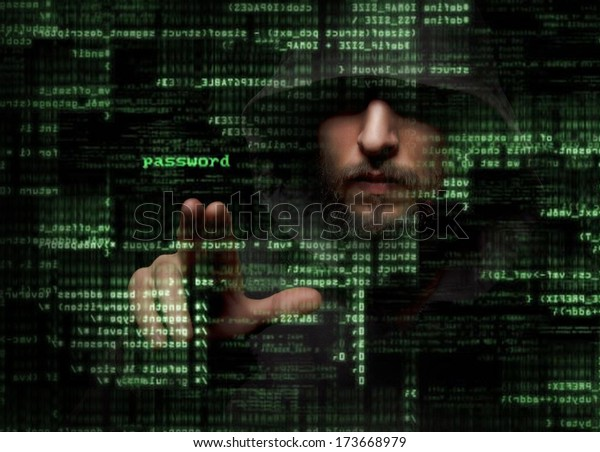 Silhouette of a hacker looking in monitor with binary codes and words