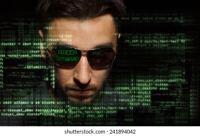 Silhouette of a hacker on graphic user interface