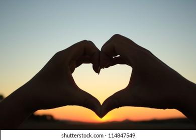 silhouette hand in heart shape