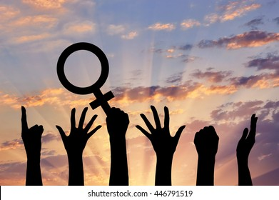 Silhouette of hand movements feminists holding the symbol of Venus mirror. feminist concept
