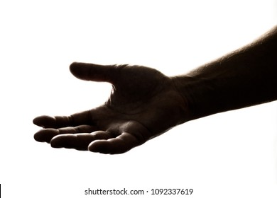 Silhouette of hand reaching out to give, or to receive help/money/hope/gift.