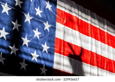 Silhouette of hand with two fingers in victory concept with flag of USA background Empty space for inscription or other objects No face Unrecognizable person