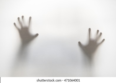 Silhouette of hands behind curtain with soft focus and blur