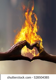 Silhouette of hands with fire in form of heart when sweethearts have touched
