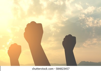 silhouette hands fist with sun lighting in morning