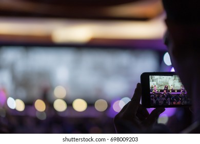 Silhouette of hands recording videos,Close up of recording video with a smartphone
