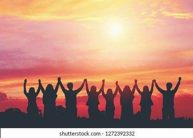 Silhouette of happy business teamwork  making high hands over head on the beautiful sky background for teamwork concept,victory,goal,business success and freedom,copy space.
