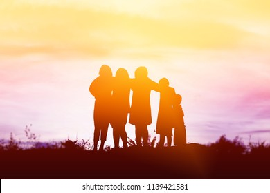 silhouette of a happy children and happy time sunset