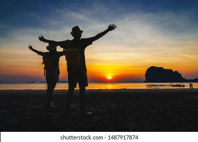 Silhouette happy couple traveler joy beautiful sunset at Pak Meng beach, Outdoor lifestyle travel Trang Thailand fun beach, Activity tourist people on summer vacation, Tourism destination Asia holiday