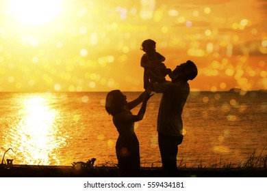 Silhouette of happy family outdoor activity, enjoying holiday together on coastline in beautiful sunset during vacations.