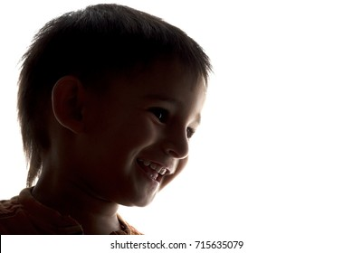 silhouette of happy laughing child face on white isolated background