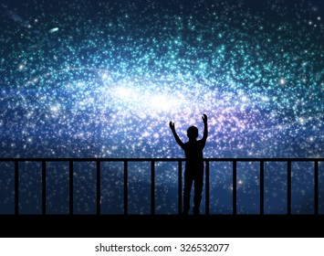 Silhouette of happy little boy on the bridge  in cosmos