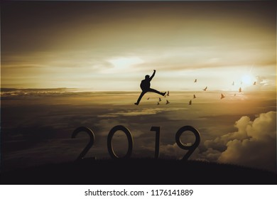 Silhouette of happy man on beautiful view. Freedom or victory concept of Happy New year 2019.