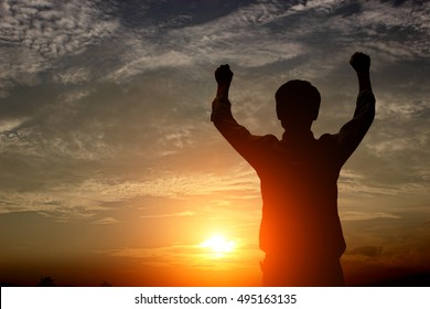 silhouette of a happy man and  sunset
