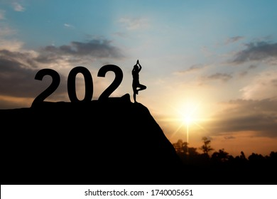 Silhouette of happy new year 2021 with woman doing yoga