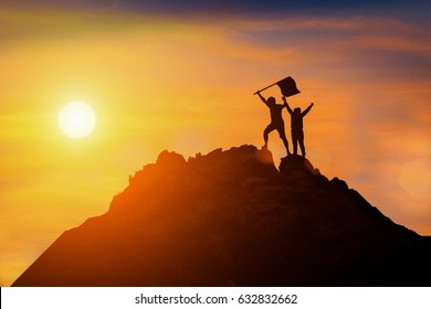 Silhouette of happy people in sunset teamwork concept