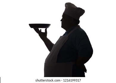 silhouette of a happy pot-bellied chief-cooker profile on a white isolated background, man in special form carrying the dish to serve,food industry concept