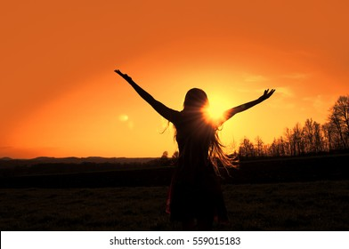 Silhouette of a happy woman