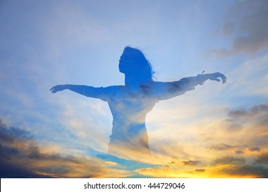 Silhouette happy woman. Double exposure, free flying woman on a background of blue sky. Abstract people.