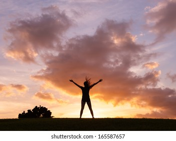Silhouette of happy woman enjoying nature. Freedom concept.