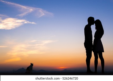 Silhouette of Happy Young Couple love Outside at Sunset
