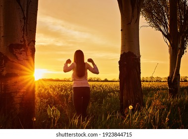 silhouette of happy young woman on sunset , outdoor girl in a field