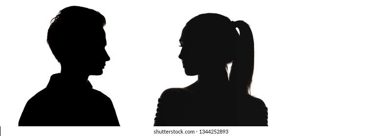 silhouette head profile of guy and a girl looking at each other,  comparison of genders, misunderstanding between men and women, concept of love and relationships on a white isolated background