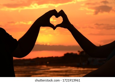 silhouette of heart at sunset