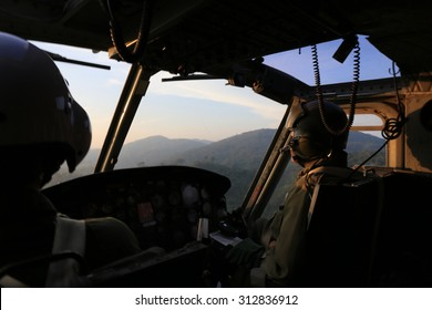 silhouette of helicopter cockpit and cockpit view