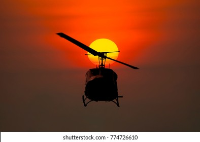 Silhouette of Helicopter on sunset background
