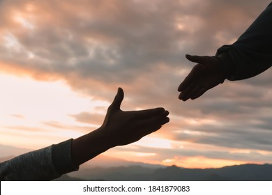silhouette of helping hand concept and international day of peace, God's helping hand.