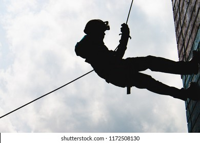 Silhouette High angle view of rappelling